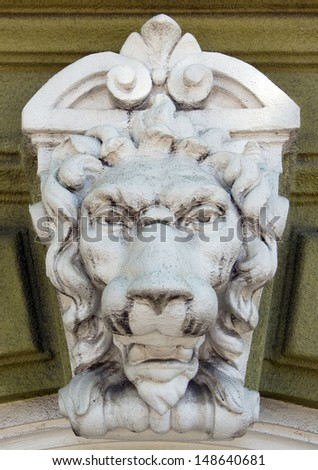 very interesting antique sculpture of the head of a lion