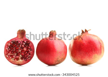 very juicy and big and delicious pomegranate in the section on white isolated background