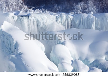 Very large amounts of ice build-up of the American Falls as seen from the Canadian side. - stock photo