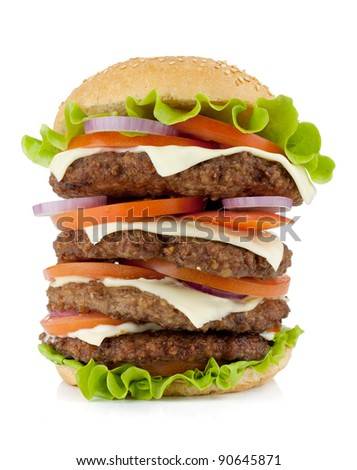 Very large burger with beef, cheese, onion and tomatoes. Isolated on white background