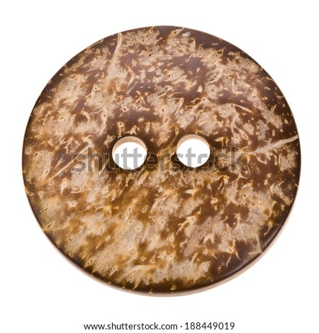 very large dark brown round button closeup isolated on white background - stock photo