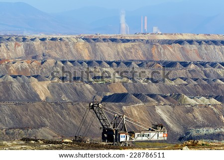Very Large excavators at work in lignite (brown coal) mine in Kozani, Greece. - stock photo