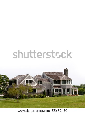 Very large house with a well manicured lawn. - stock photo