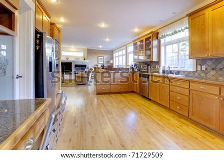 Very large open kitchen with nice wood.