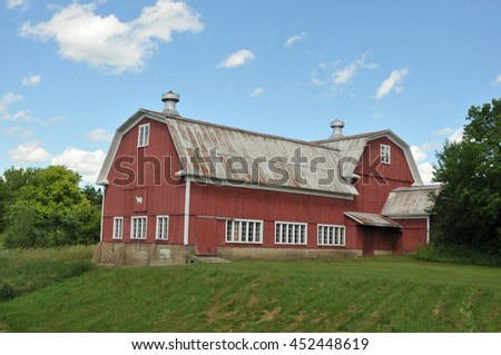 Very large red barn on a farm near Stowe, Vermont