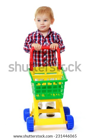Very little boy rolls a toy truck.Early years learning a happy childhood concept.Isolated on white background. - stock photo