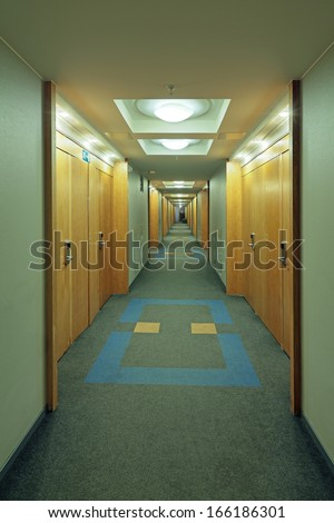 Very long corridor in a building - stock photo