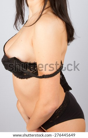 Very lovely and sensual brunette with a black lingerie - stock photo