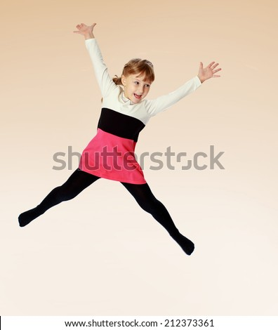 very mobile little girl jumping high arms spread.the concept of a happy childhood, education of children, teens - stock photo