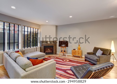 Very modern artistic living room with lots of color and abstract rug. - stock photo
