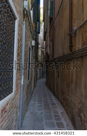 Very narrow old, vintage street in Venice. Curvy narrow road in Venice that caused me fear.  - stock photo