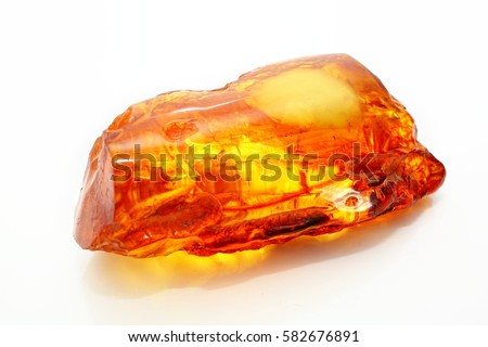 Very nice amber on a white background. Orange amber with inclusions and a beautiful yellow shade. Transparent polished amber yellow