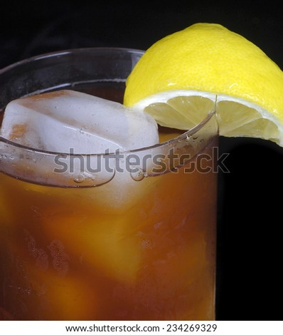 Very Nice Image of Iced tea isolated on Black with a lemon wedge - stock photo