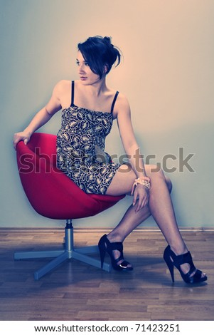 Very nice lady on chair in studio