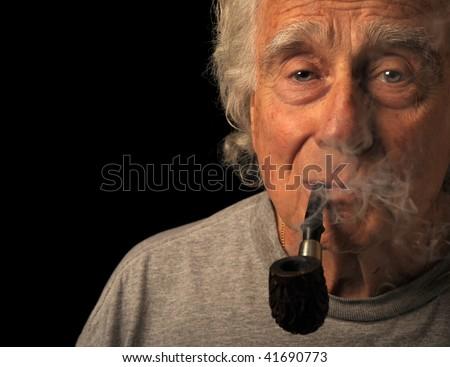 Very Nice Portrait Image of a senior man Smoking a pipe - stock photo