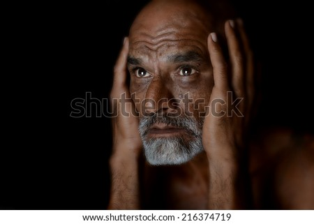 very Nice portrait of a Indian man on Black - stock photo