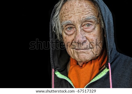 Very nice Portrait Of a senior man In Hood - stock photo
