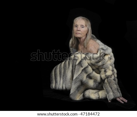 Very Nice Portrait of a senior woman In Fur on Black - stock photo