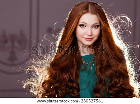 very nice sensual girl with red hair backlit - stock photo