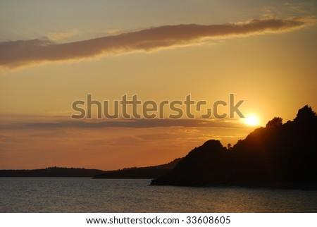 Very nice sunset on a greek beach - stock photo