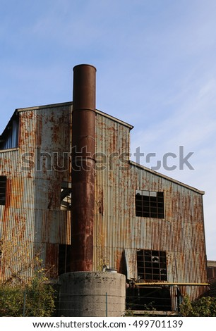 very old abbandoned factory with high chimney