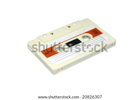 Very old analog audio cassette. Isolated on white background. - stock photo