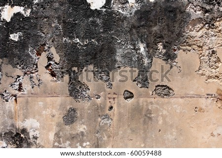 Very old and grungy concrete wall with cracks and stains. - stock photo