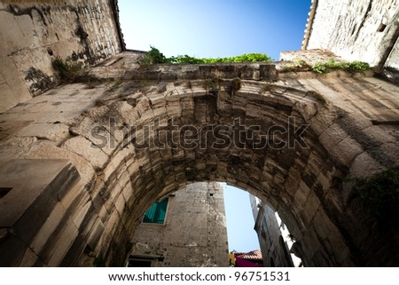 Very old and interesting arch in the old city streets in Split downtown, Croatia. - stock photo
