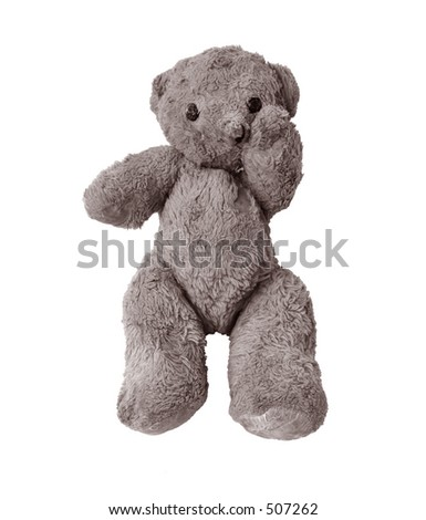 Very old and worn Teddy bear in sad pose because he got left behind by a child after stay in hospital - stock photo