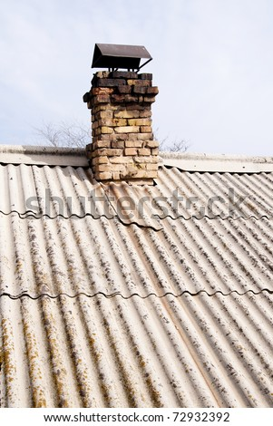 very old asbestos board housetop - stock photo
