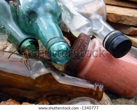 Very old bottles thrown to a sewer - stock photo
