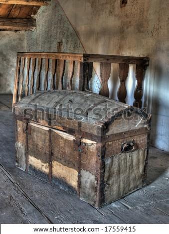 Very old box in the attic like pirate treasure box.High dynamic range image. - stock photo
