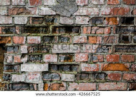 Very old brick wall, brick background, is destroyed - stock photo