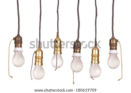 very old bulb fitting with light - stock photo