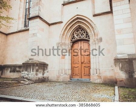very old church entrance at prague with orange door