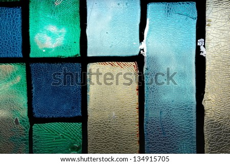 Very old crannied stained glass window texture background - stock photo
