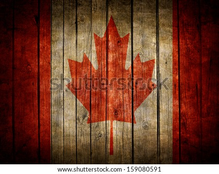 Very old dark brown wooden planks background with Canadian flag painted on it - stock photo