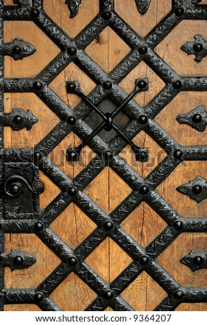 Very old door to a castle. - stock photo