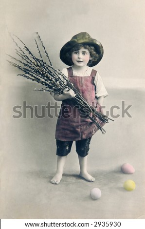 Very old Easter greeting, motive of cute boy with pussy willow twigs - stock photo