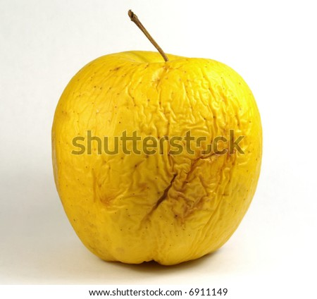 Very old golden apple - stock photo