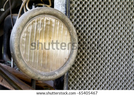 Very Old Headlight and Radiator close up. Model T. - stock photo