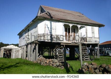 Very Old House Lifted up for Moving - stock photo