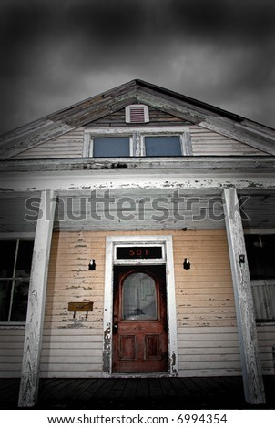Very Old House Under Cloudy Sky - stock photo