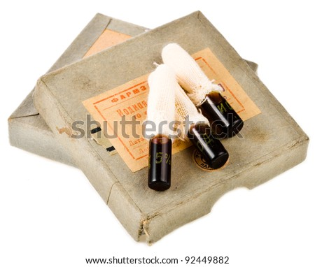 Very old 1940 iodine capsules under the white background - stock photo