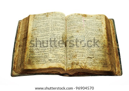 Very old open bible book isolated on white