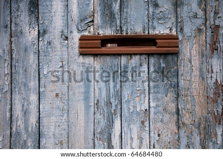 very old postbox in weathered wooden fence - stock photo
