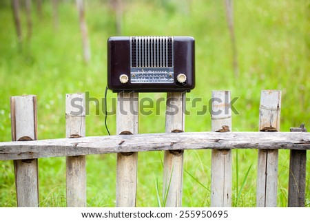Very Old Radio Transistor with grass background - stock photo
