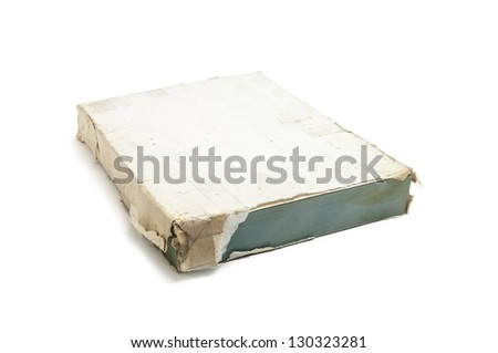 Very old ream of powder blue paper with torn wrapper yellowed by age, isolated on a white background.