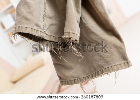 very old ripped worn trousers - stock photo