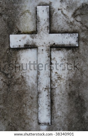 Very old Rusted Cross made of stone - stock photo